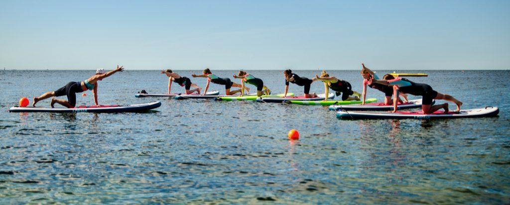 SUP-yoga i Malmö med Nellie Rolf